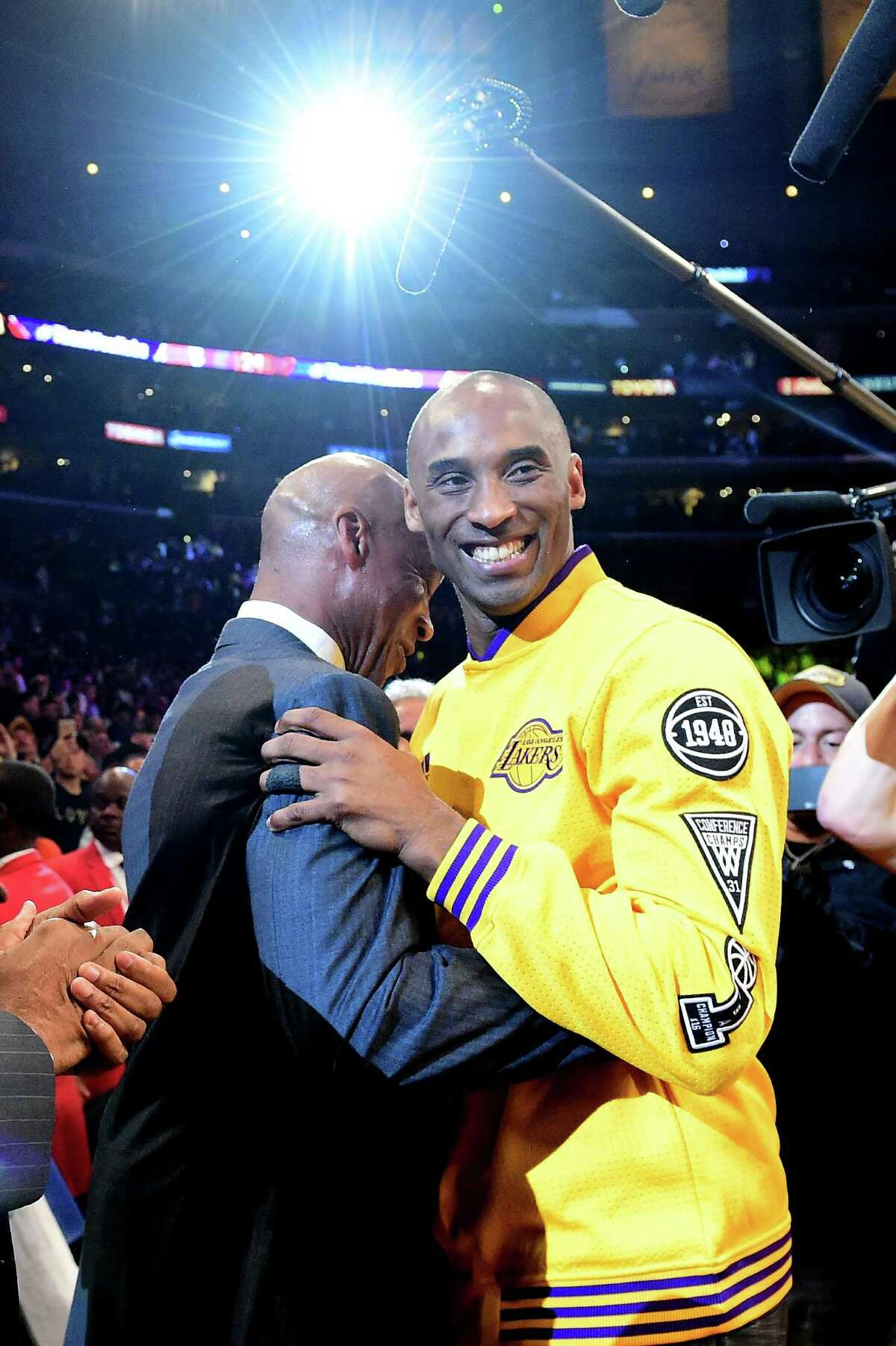 LOS ANGELES, CA - APRIL 13: Kobe Bryant #24 of the Los Angeles Lakers hugs head coach Byron Scott before taking on the Utah Jazz in Bryant's final NBA game at Staples Center on April 13, 2016 in Los Angeles, California. NOTE TO USER: User expressly acknowledges and agrees that, by downloading and or using this photograph, User is consenting to the terms and conditions of the Getty Images License Agreement.