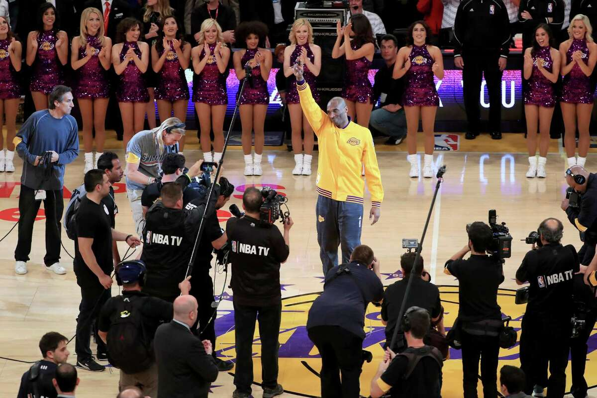 LOS ANGELES, CA - APRIL 13: Kobe Bryant #24 of the Los Angeles Lakers waves to the crowd before taking on the Utah Jazz in Bryant's final NBA game at Staples Center on April 13, 2016 in Los Angeles, California. NOTE TO USER: User expressly acknowledges and agrees that, by downloading and or using this photograph, User is consenting to the terms and conditions of the Getty Images License Agreement.