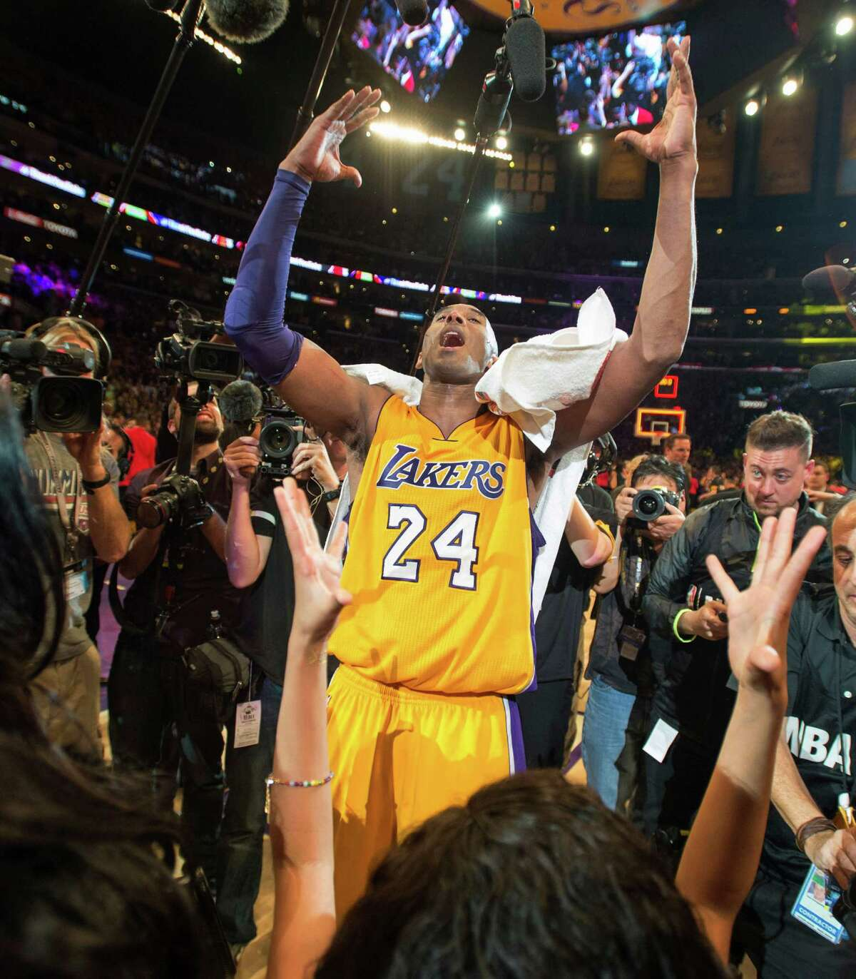 Los Angeles Lakers' forward Kobe Bryant reacts after an NBA basketball game against the Utah Jazz at Staples Center in Los Angeles, on Wednesday, April 13, 2016. Kobe Bryant went out with a Hollywood ending to his remarkable career. He scored 60 points in his final NBA game Wednesday night, wrapping up 20 years in the NBA with an unbelievable offensive showcase in the Lakers' 101-96 victory over the Utah Jazz. (Michael Goulding/The Orange County Register via AP) MAGS OUT; LOS ANGELES TIMES OUT; MANDATORY CREDIT