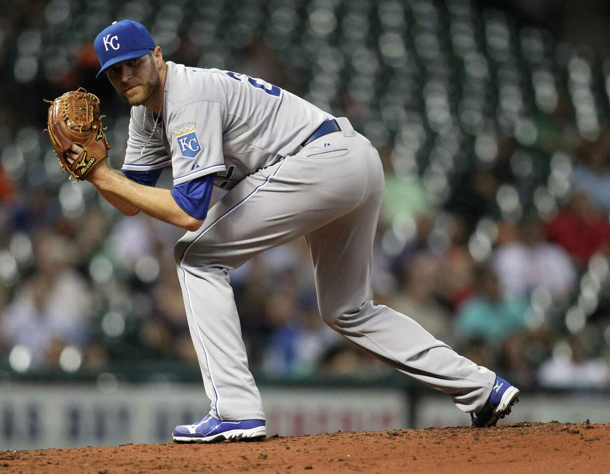 Kansas City Royals starting pitcher Wade Davis (22) looks back at the runner on first base during the second inning of an MLB game at Minute Maid Park, Tuesday, May 21, 2013, in Houston. ( Karen Warren / Houston Chronicle )