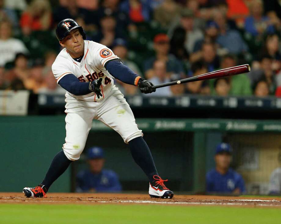 It was a reach and George Springer  didn't come up with it in the first inning, striking out for the first of three times during  Wednesday night's game at Minute Maid Park. Photo: Karen Warren, Staff / © 2016 Houston Chronicle