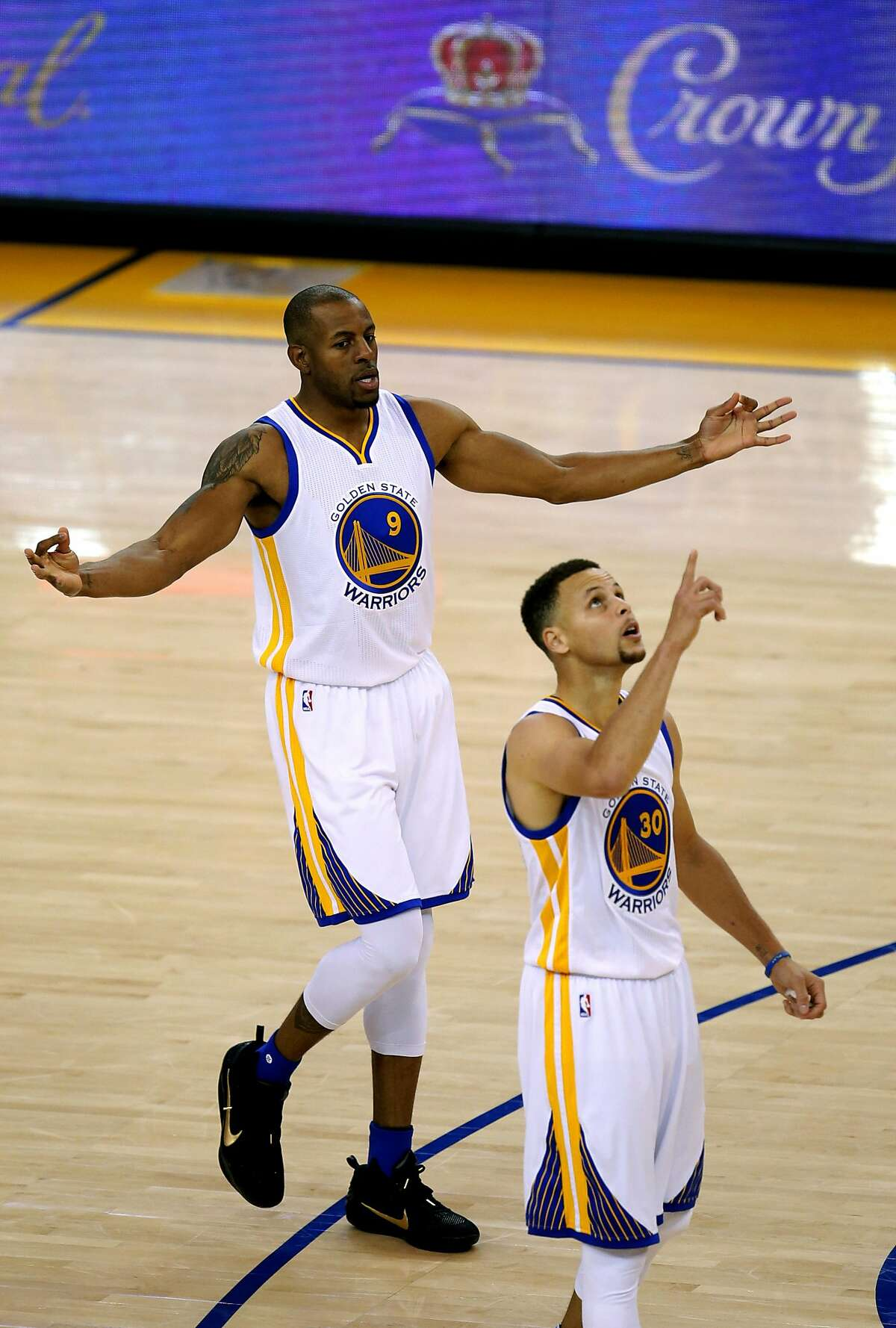 Warriors' Andre Iguodala, (9) celebrates with Stephen Curry, (30) afdter his fifth 3 pointer in the first quarter, as the Golden State Warriors take on the Memphis Grizzlies at the Oracle Arena in Oakland, California on Wed. April 13, 2016.