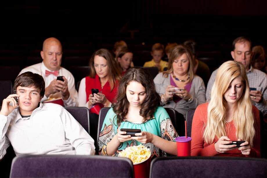 The new moviegoing experience: a text-friendly theater. Photo: Getty Images