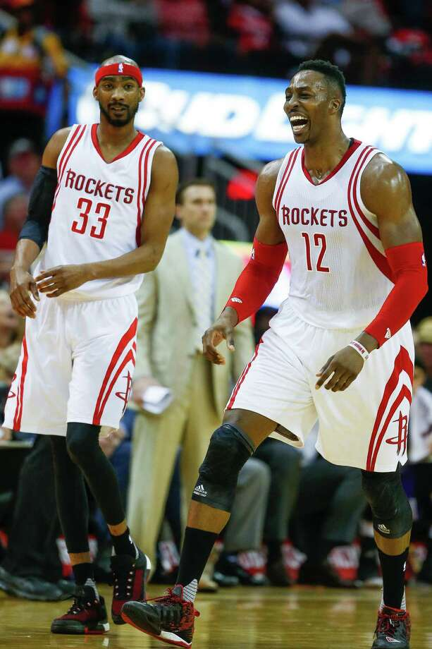 Houston Rockets center Dwight Howard (12) laughs after missing a third quarter buzzer beater as the Houston Rockets beat the Sacramento Kings 116-81 at the Toyota Center and head to the playoffs Wednesday, April 13, 2016 in Houston. ( Michael Ciaglo / Houston Chronicle ) Photo: Michael Ciaglo, Staff / © 2016  Houston Chronicle
