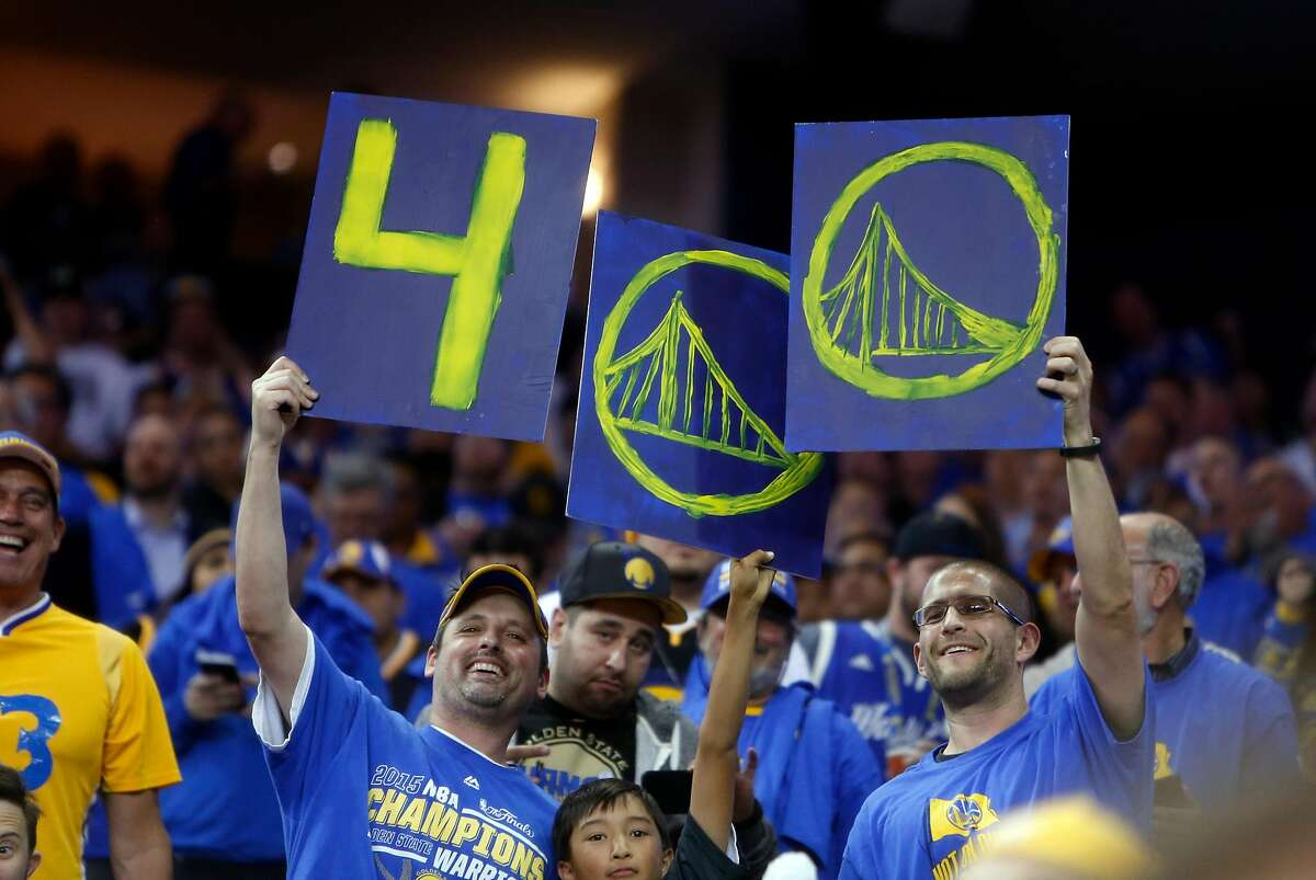 Golden State Warriors' fans celebrate Stephen Curry's 400th 3-pointer of the season.