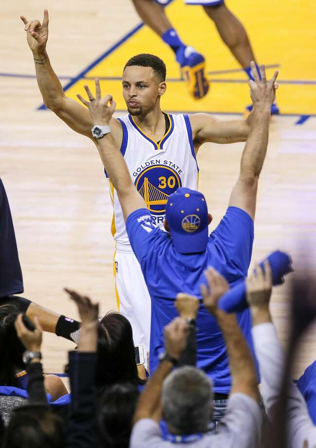 Stephen Curry celebrates his 400th three point shot of the season during the third quarter as the Golden State Warriors take on the Memphis Grizzlies ,at the Oracle Arena in Oakland, California on Wed. April 13, 2016. Photo: Michael Macor, The Chronicle