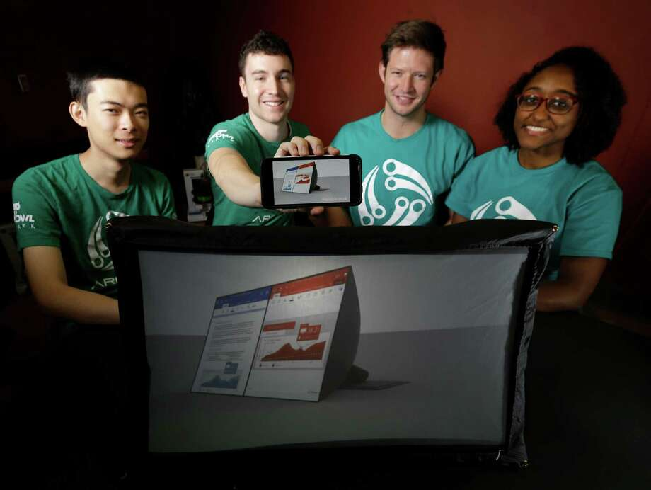 George Zhu, Alexander Wesley, Jake Herzig and Jasmine Richards created a 24-inch screen that collapses to a paperback's size.  Photo: Melissa Phillip, Staff / © 2016 Houston Chronicle