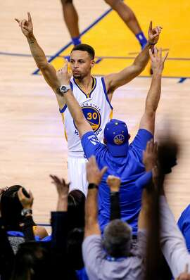 Stephen Curry celebrates his 400th three point shot of the season during the third quarter as the Golden State Warriors take on the Memphis Grizzlies ,at the Oracle Arena in Oakland, California on Wed. April 13, 2016.