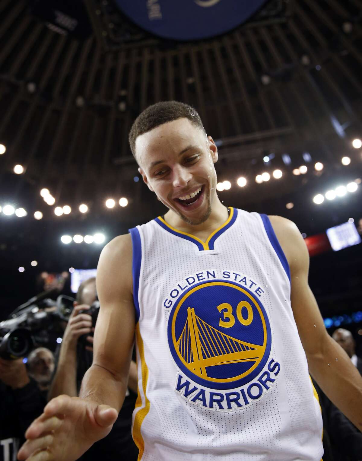Golden State Warriors' Stephen Curry reacts to being doused by water after 73rd win, a victory over Memphis Grizzlies during NBA game at Oracle Arena in Oakland, Calif., on Wednesday, April 13, 2016.