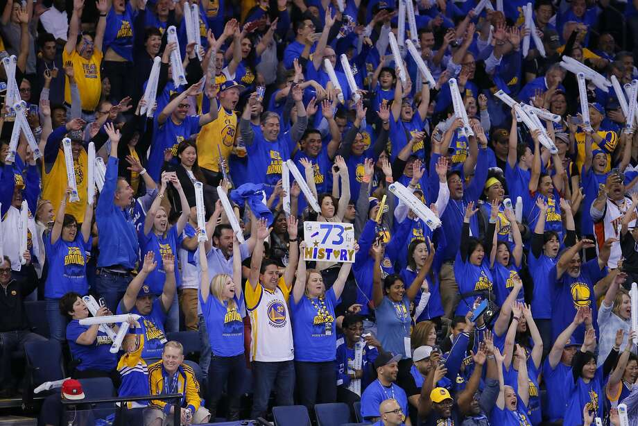 Fans celebrate as the Golden State Warriors beat the Memphis Grizzlies, 125-104 at the Oracle Arena in Oakland, California on Wed. April 13, 2016. Photo: Michael Macor, The Chronicle