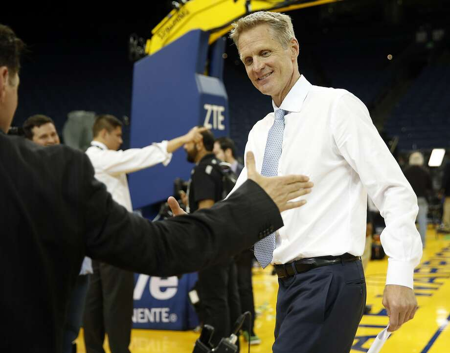 Golden State Warriors' head coach Steve Kerr is congratulated by Greg Papa after win over Memphis Grizzlies, Warrioprs' 73rd of season, during NBA game at Oracle Arena in Oakland, Calif., on Wednesday, April 13, 2016. Photo: Scott Strazzante, The Chronicle