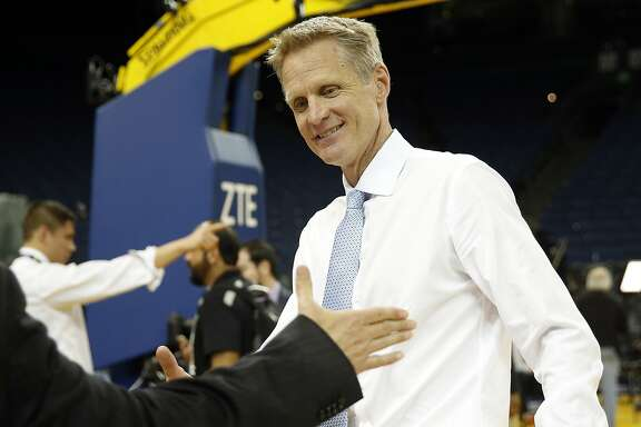 Golden State Warriors' head coach Steve Kerr is congratulated by Greg Papa after win over Memphis Grizzlies, Warrioprs' 73rd of season, during NBA game at Oracle Arena in Oakland, Calif., on Wednesday, April 13, 2016.