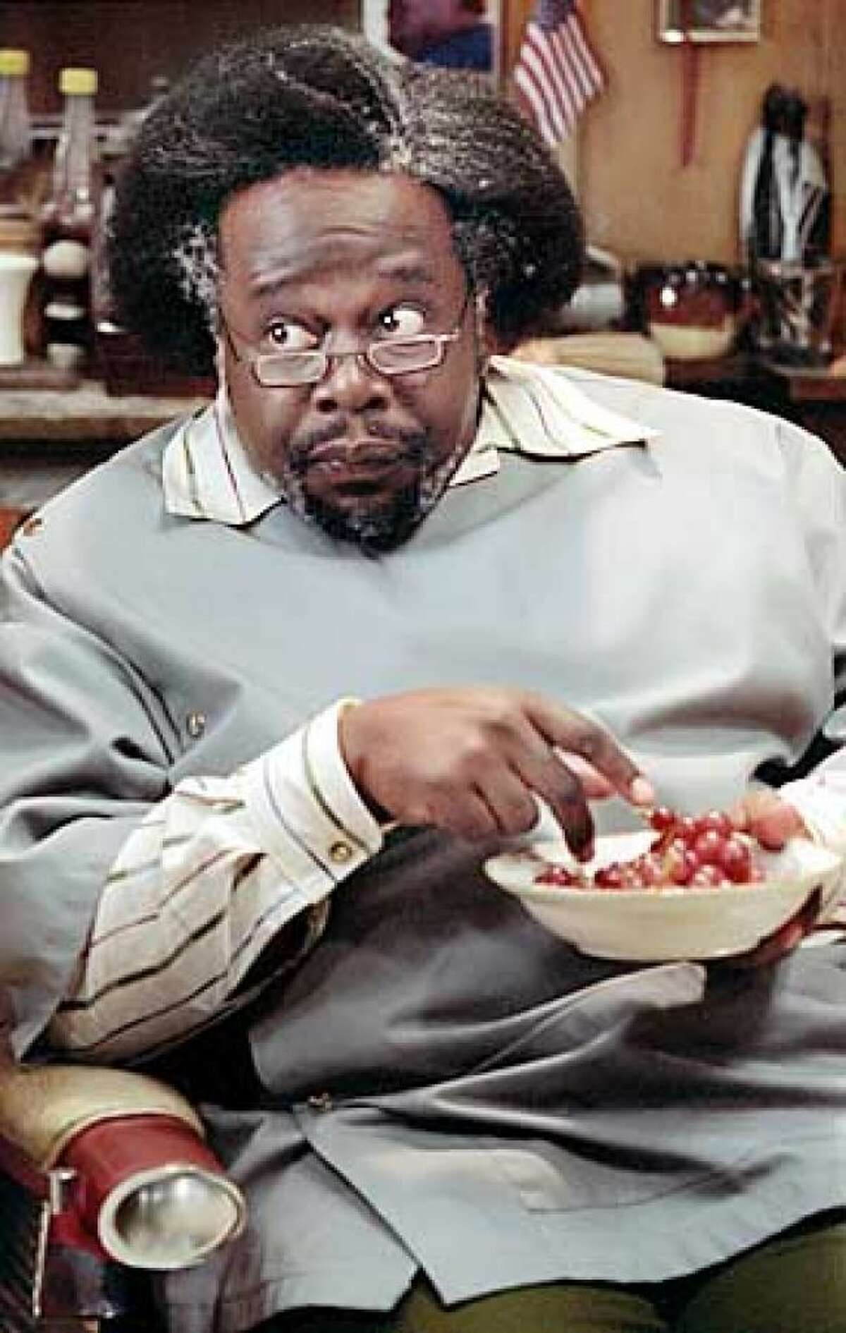 Cedric the Entertainer, who was hysterical in the original BARBERSHOP (2002).