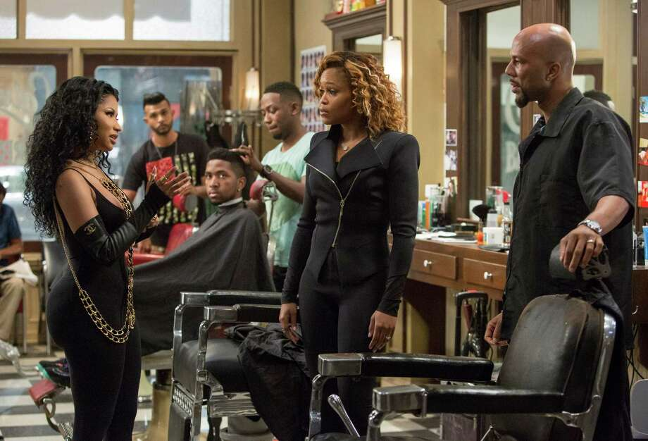 "In this image released by Warner Bros., Nicki Minaj, foreground from left, Eve and Common appear in a scene from ""Barbershop: The Next Cut."" (Chuck Zlotnick/Warner Bros. via AP) Photo: Chuck Zlotnick, HONS / AP / Warner Bros."
