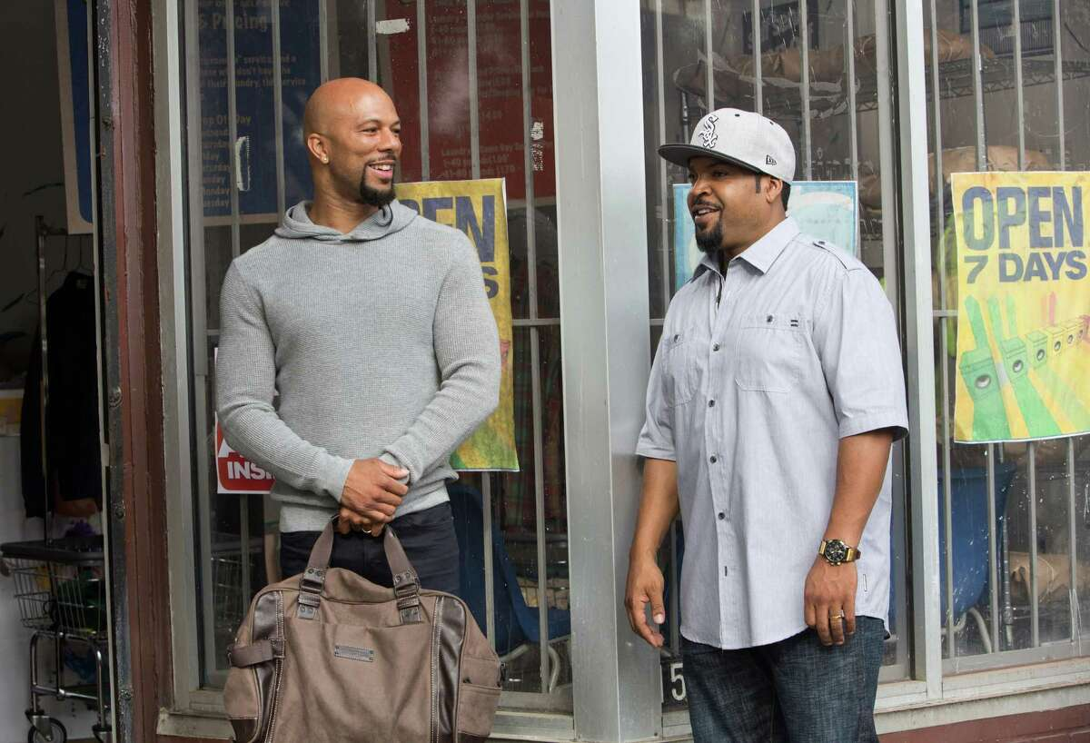In this image released by Warner Bros., Ice Cube, right, and Common appear in a scene from