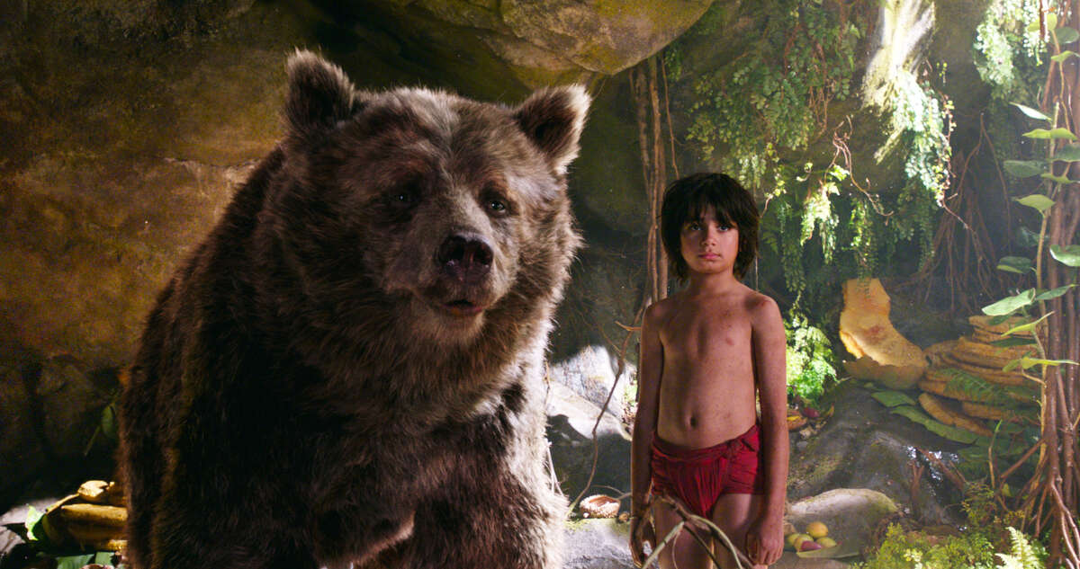 Mowgli, portrayed by Neel Sethi, and Baloo the bear, voiced by Bill Murray, appear in a