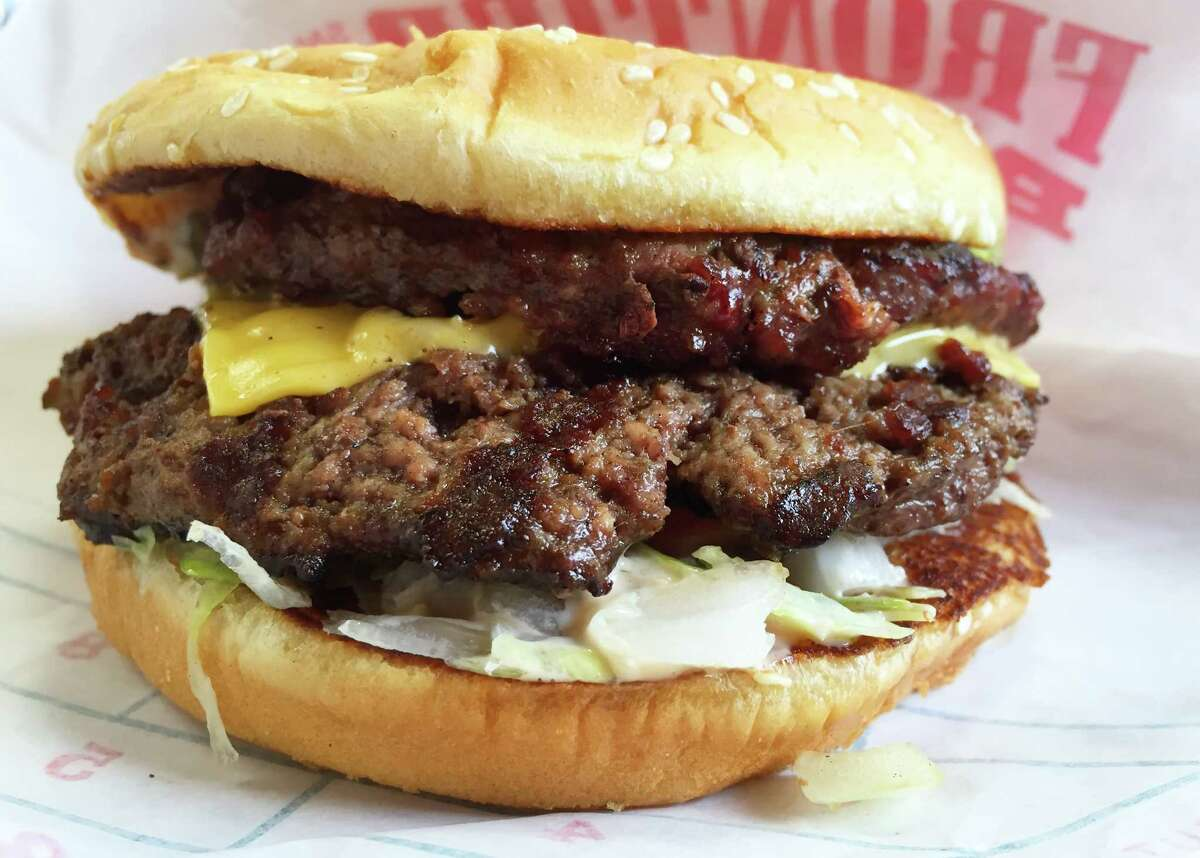 The Frontier Burger consists of two beef patties with cheese, lettuce, tomato, onions and Frontier special sauce.