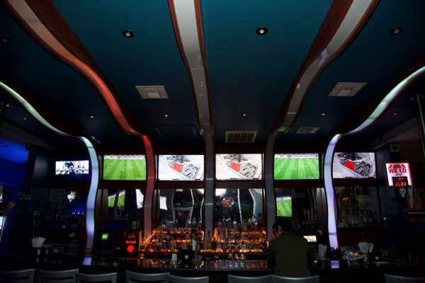 The bar with Flat screen televisions showing soccer at Sports Haus Bar.