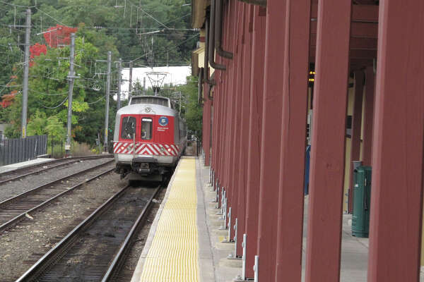 A shuttle train leaves the Elm Street station Thursday morning. Mechanical failures have disrupted the service on the New Haven line of the Metro North. Sept. 26, 2013. New Canaan, Conn.
