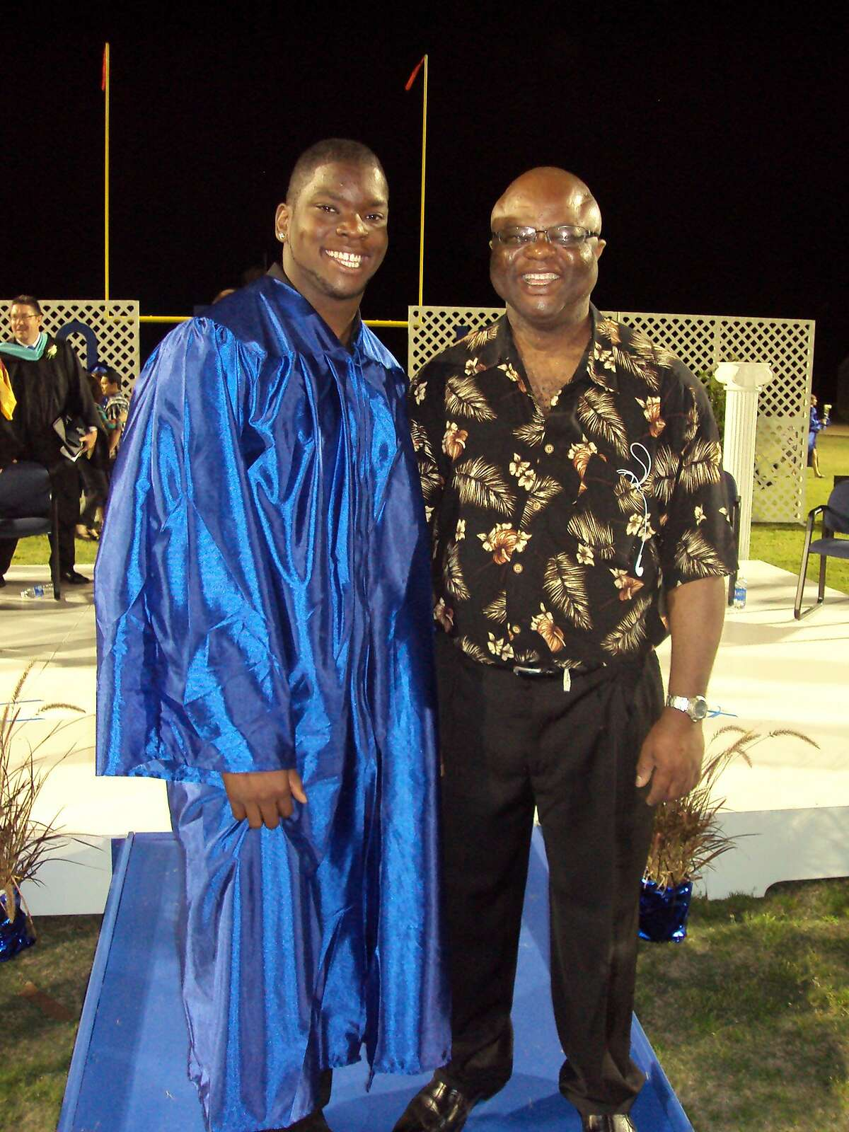 Ted Agu and his father, Ambrose, at his high school graduation.