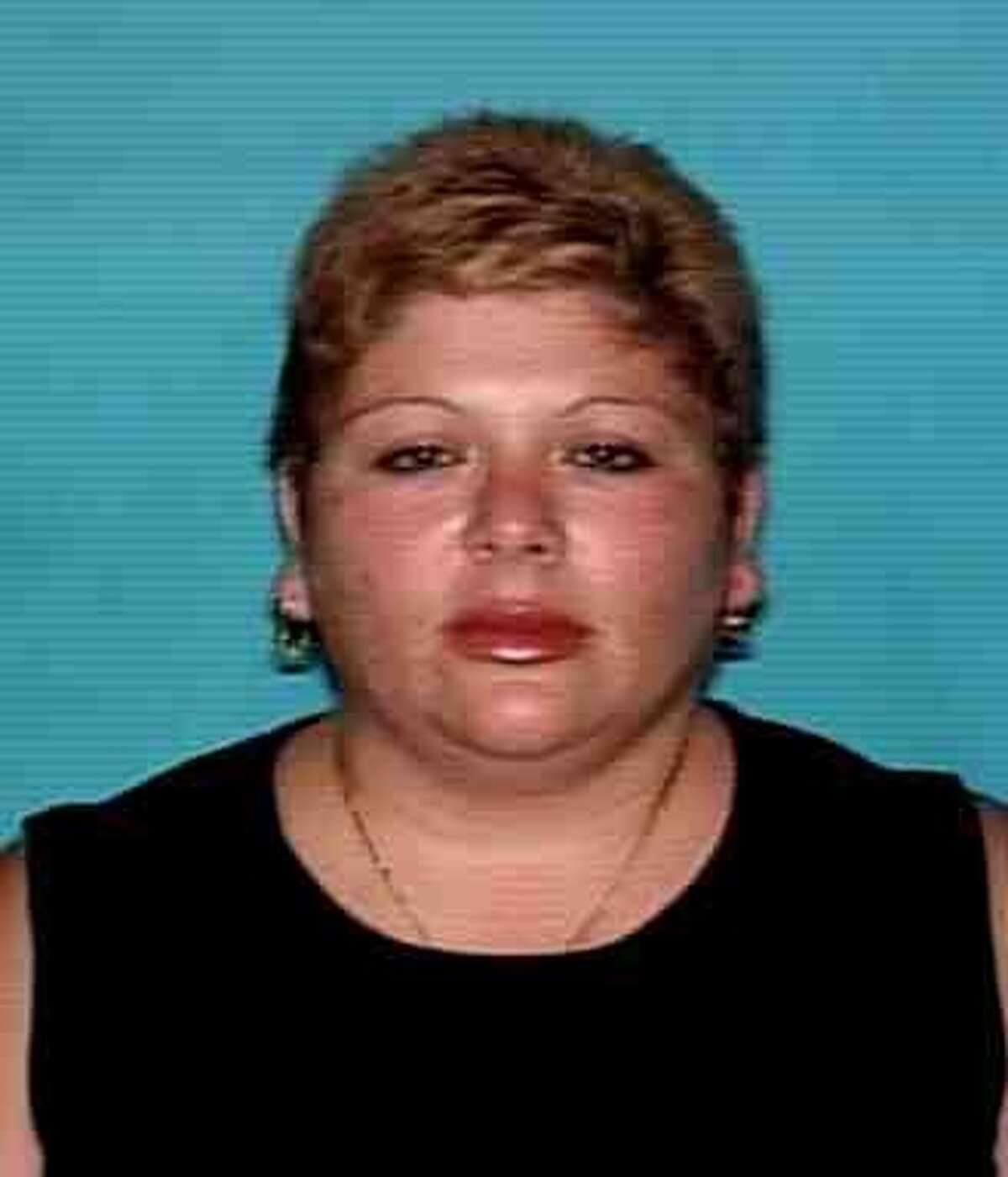 Patricia Flores, 43, is wanted on a warrant for injury to a child - serious bodily injury/omission in Haltom City.