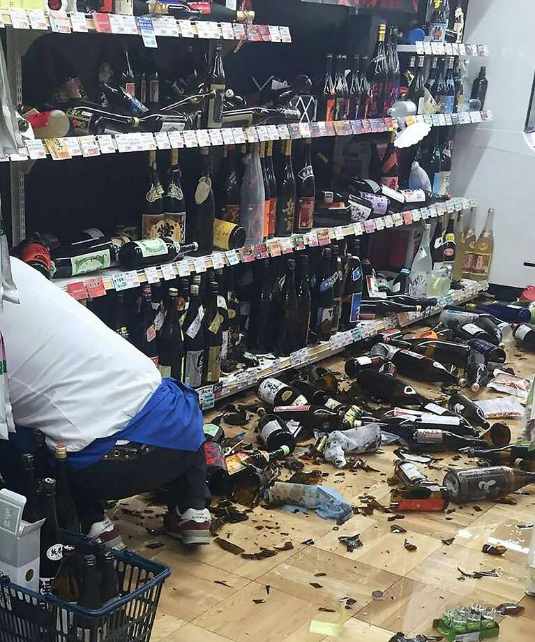A shop clerk cleans broken wine bottles following an earthquake in Kumamoto city on April 14, 2016.  The strong 6.4-magnitude earthquake struck at 9:26 pm (1226 GMT) in Kumamoto, central Kyushu at a relatively shallow depth of 10 kilometres (6.2 miles), the Japan Meteorological Agency said.    ==JAPAN OUT== / AFP PHOTO / JIJI PRESS / JIJI PRESSJIJI PRESS/AFP/Getty Images Photo: JIJI PRESS, AFP/Getty Images