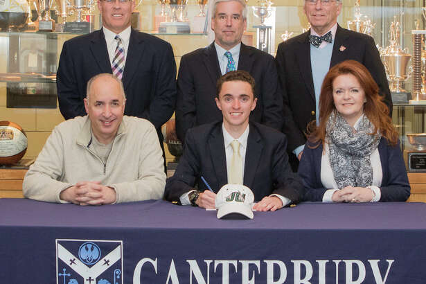 """Thomas Esposito, the son of Kevin and Mary Esposito, formerly of New Milford, and a senior at Canterbury School in New Milford, has signed a letter of intent to be a coxswain for the University of Jacksonville, a Division I program. """"Before coming to Canterbury, I had not excel at a sport,"""" Thomas said. """"Attending Canterbury offered me the opportunity to try crew,"""" he said. Thomas said he initially tried rowing but Coach Timothy O'Keefe put """"me in the coxswain seat and I soon realized how much I loved that role and how I could be a valuable contributor to an exciting sport."""" Thomas said he is """"passionate about (his) roles as a coxswain and (has) grown as a student and as an athlete."""" Above, Thomas, front seated, is joined by his parents. Congratulating Thomas are, in back, from left to right, David Wilson, director of athletics, Coach O'Keefe and Thomas J. Sheehy III, headmaster."""