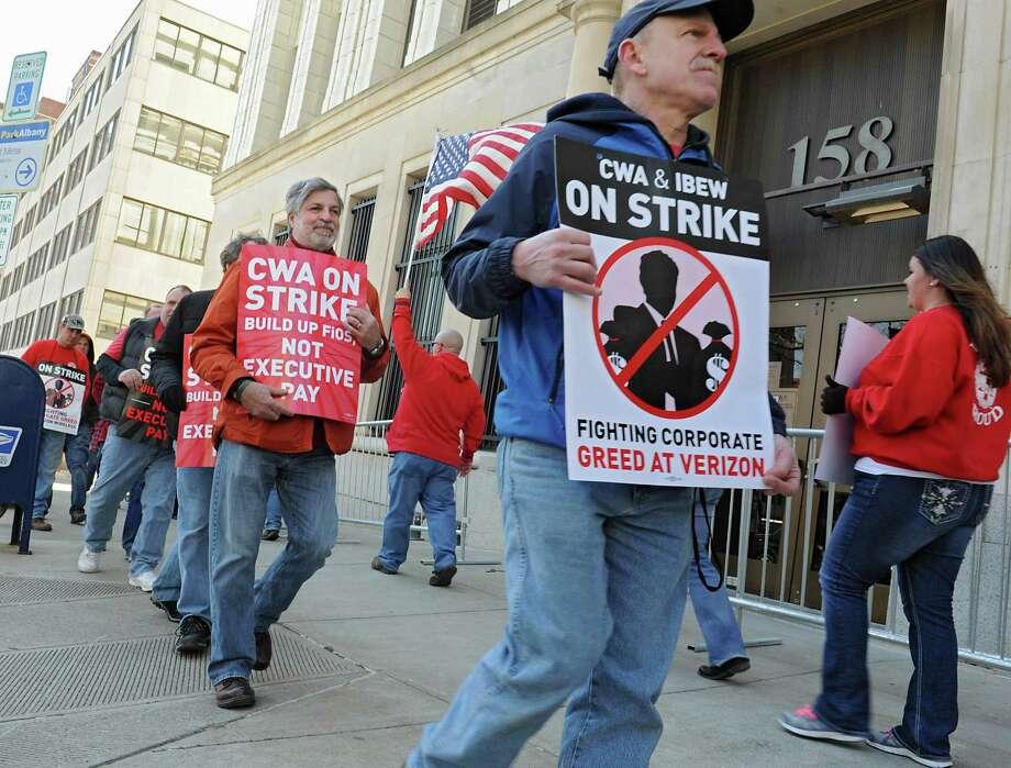 Verizon workers walk in a picket line during a strike outside the Verizon Building on Wednesday April 13, 2016 in Albany, N.Y.  (Lori Van Buren / Times Union) Photo: Lori Van Buren / 10036184A