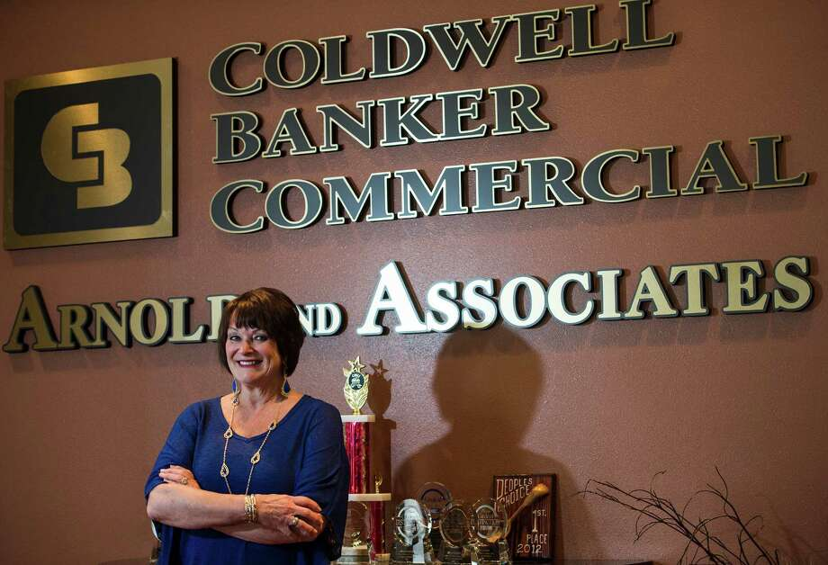 Sheri Arnold poses for a photograph at the Beaumont offices of Coldwell Banker Commercial real estate Thursday afternoon. Coldwell Banker Commercial real estate is renovating the Finger Furniture warehouse off 7th Street. Photo taken Thursday, 4/17/14 Contributed illustration Photo: Jake Daniels / ©2014 The Beaumont Enterprise/Jake Daniels