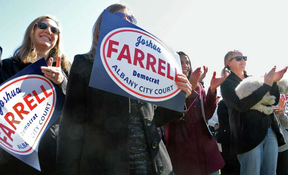 Supporters cheer as Joshua Farrell announces his candidacy for Albany City Court Judge at Westland Hills Park. Thursday April 14, 2016 in Albany, NY. Farrell is currently an assistant attorney general with New York State. (John Carl D'Annibale / Times Union)