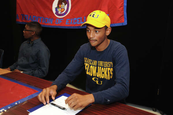 Justus Swint during a college signing ceremony at West Brook on Wednesday. Swint has committed to  Graceland University. Photo taken Wednesday, April 13, 2016 Guiseppe Barranco/The Enterprise