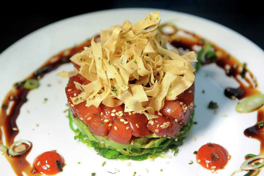 Hawaiian Style Tuna Poke with sesame crisp, seaweed salad, avocado and sweet soy on Thursday, April 7, 2016, at Hamlet and Ghost in Saratoga Springs, N.Y. (Cindy Schultz / Times Union) Photo: Cindy Schultz / Albany Times Union