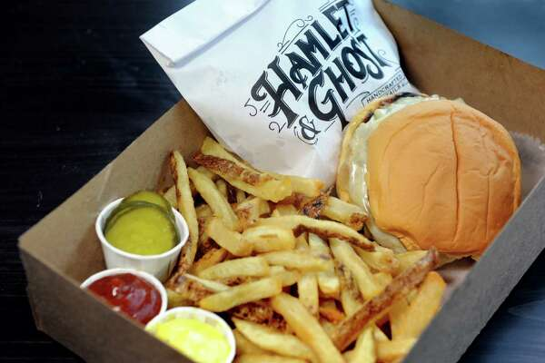 Ghost Burger with carmelized onions, American cheese and frieds on Thursday, April 7, 2016, at Hamlet and Ghost in Saratoga Springs, N.Y. (Cindy Schultz / Times Union)