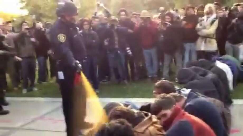 A campus police officer pepper-sprays protesters at UC Davis, Nov. 18, 2011. Photo: Thomas K. Fowler, AP