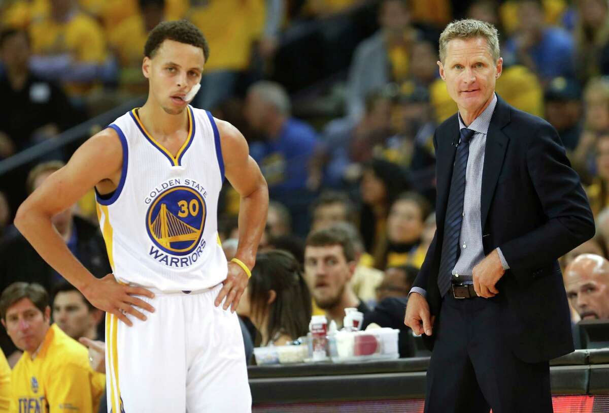 Golden State Warriors head coach Steve Kerr and Golden State Warriors guard Stephen Curry (30) stand together during a break in play during the first period of Game 1 of the NBA Western Conference Finals against the Houston Rockets at Oracle Arena on Tuesday, May 19, 2015, in San Francisco .