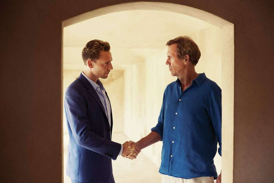 """Jonathan Pine (Tom Hiddleston) befriends charming but morally corrupt chemical weapons dealer Richard Roper (Hugh Laurie) in an attempt to stop his globally threatening operations in AMC's adaptation of the John le Carré novel """"The Night Manager."""" Photo: Mitch Jenkins /AMC / © 2016 AMC Network Entertainment LLC. All Rights Reserved."""