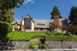 The Berkeley home sits away from the street and behind a stone barrier.�