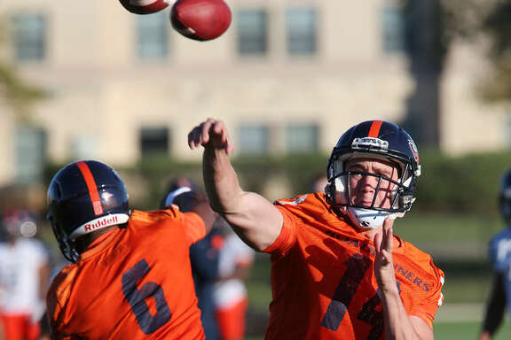 UTSA quarterbacks Dalton Sturm, right, of Goliad, Texas and Jaylon Henderson, of Kingwood, Texas, go through drills during the first day of Spring Training at the main campus, Monday, March 21, 2016.