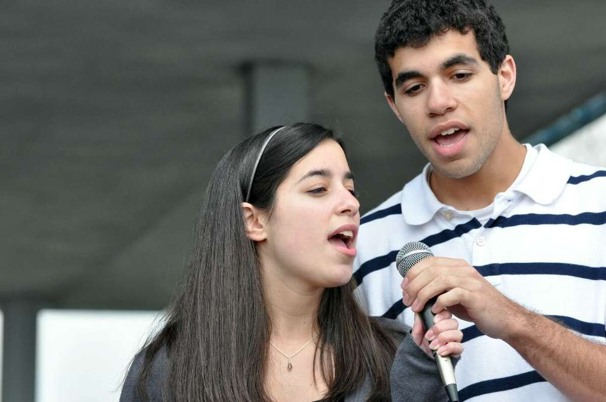 Staples High School siblings, Jaimee and Jake Yarmoff sing the National Anthem during the second annual Create Footprints Run/Walk in the fight against Lyme disease on Sunday, Apr. 11, 2010 at Sherwood Island State Park.