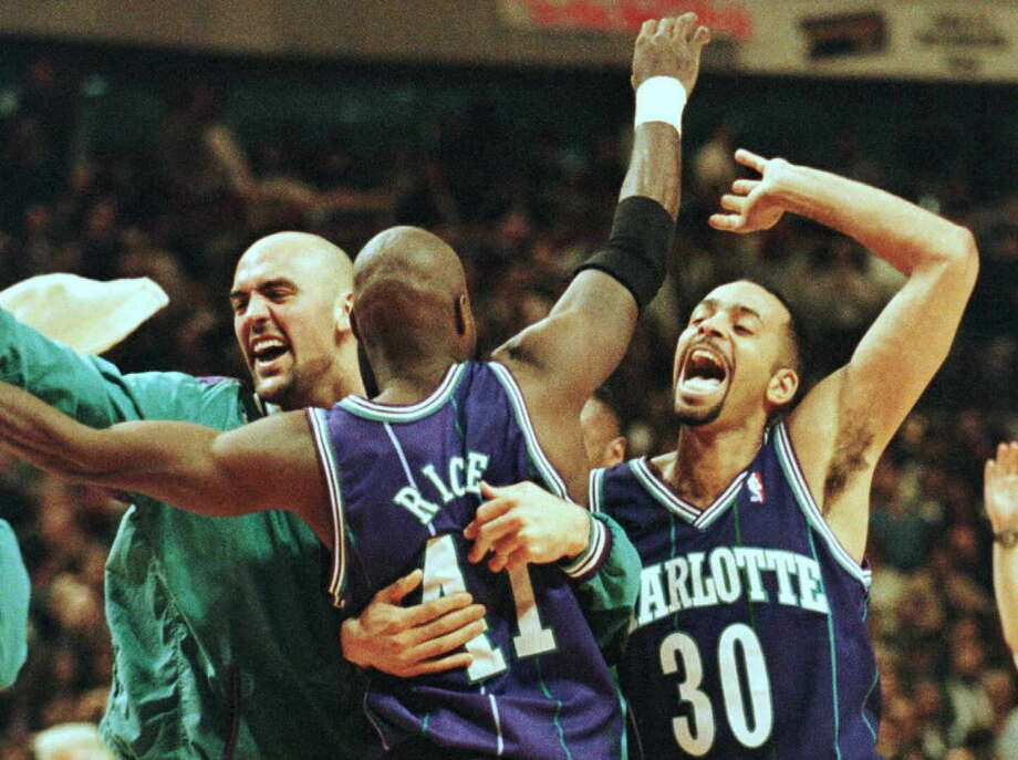 Charlotte Hornets players Dell Curry(R), Glen Rice(C) and Matt Geiger(L) hug each other after defeating the Chicago Bulls 98-87 at the United Center 08 April in Chicago. The Hornets are the only team to have beat the Bulls at home this year, ending the Bulls record home-winning streak at 44. Photo: Brian Bahr, AFP/Getty Images