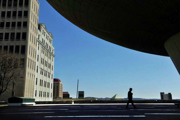 A New York State Trooper makes his way past the Egg on the Empire State Plaza on Thursday, April 14, 2016, in Albany, N.Y.  (Paul Buckowski / Times Union)