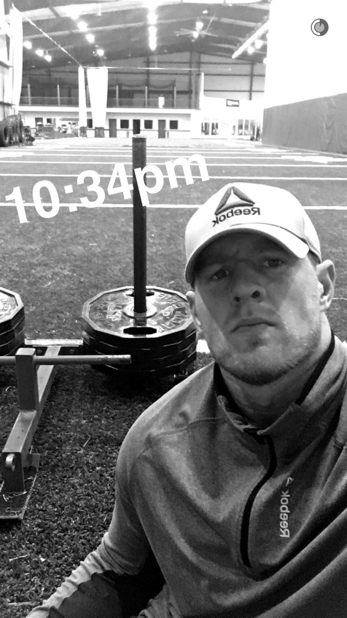 Houston Texans' star J.J. Watt posted a video of him in his Wisconsin gym at 10:34 p.m. Wednesday night.