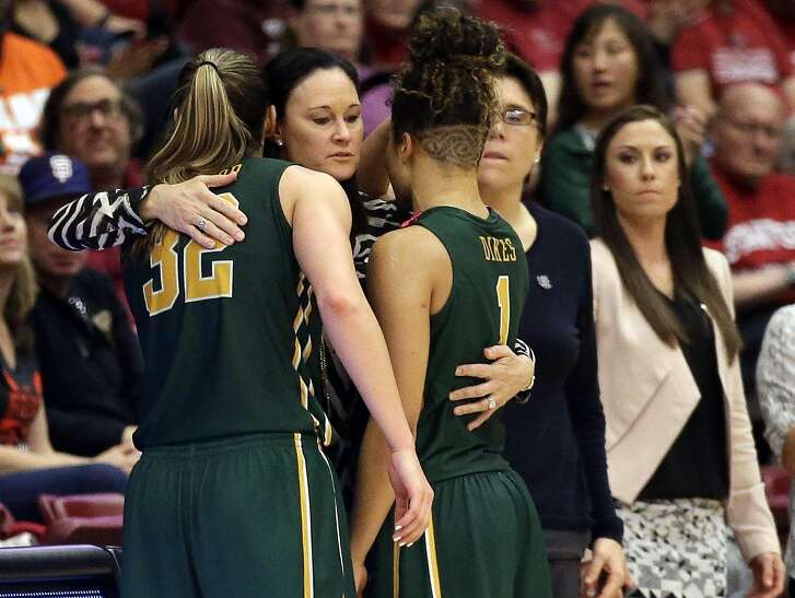 San Francisco head coach Jennifer Azzi, center, hugs forward Taylor Proctor (32) and guard Zhane Dikes (1) in the closing seconds of 85-58 loss to Stanford in a first-round women's college basketball game in the NCAA Tournament Saturday, March 19, 2016, in Stanford, Calif. (AP Photo/Marcio Jose Sanchez)