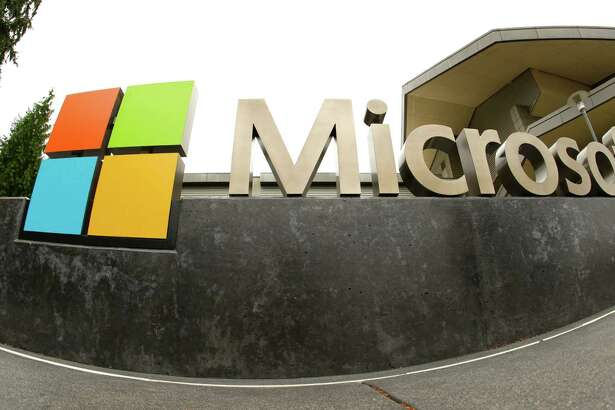 This file photo shows the Microsoft Corp. logo outside the Microsoft Visitor Center in Redmond, Wash. In a lawsuit filed last week, Microsoft is suing the U.S. government over a federal law that lets authorities examine its customers email or online files without the customers knowledge. The lawsuit comes as the tech industry is increasingly butting heads with U.S. officials over customers privacy rights.