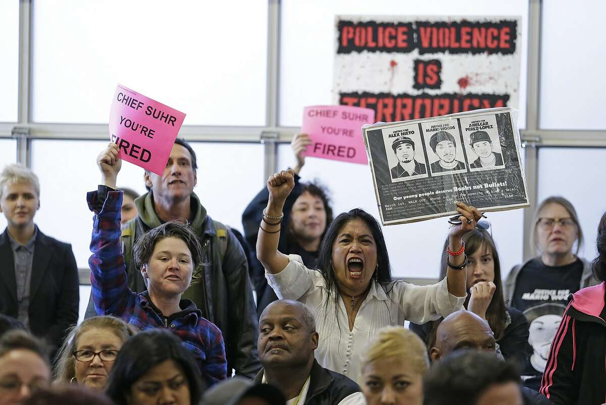 People yell for the firing of San Francisco police chief Greg Suhr during a town hall meeting to provide the Mission District neighborhood with an update on the investigation of an officer involved shooting Wednesday, April 13, 2016, in San Francisco. The meeting came after 45-year-old Luis Gongora was shot and killed by police at a homeless encampment on Thursday, April 7, 2016. (AP Photo/Eric Risberg)