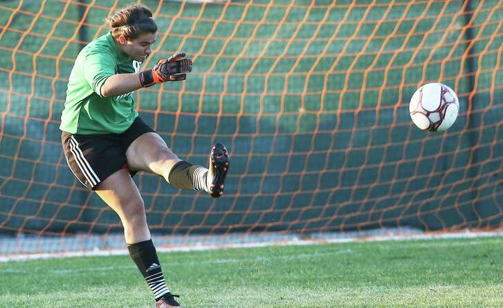 MacArthur goalkeeper Mary Cardone punches the ball away as the MacArthur girls play Johnson  in 6A soccer playoffs at Blossom West  on April 5, 2016.