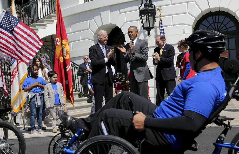 President Obama and Vice President Joe Biden applaud veterans participating in the annual Wounded Warrior Ride at the White House to help raise awareness about severely injured vets. Photo: Pool, Getty Images