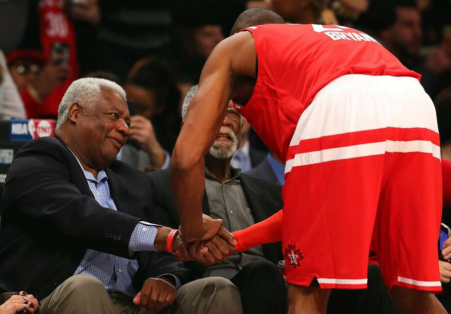 Kobe Bryant speaks to NBA Hall of Famers Oscar Robertson and Bill Russell before the NBA All-Star Game 2016 at the Air Canada Centre in February in Toronto. Robertson has dismissed Curry's achievements as the product of clueless coaching and gutless defense. Photo: Elsa, Getty Images