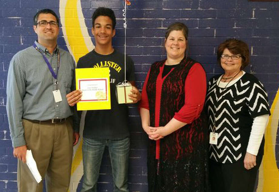 Joey Fusilier is surrounded by MMS Principal Todd Loupe, BBB representative Michelle Brewer, to Joey's left, and MMS Counselor Janet Peno.