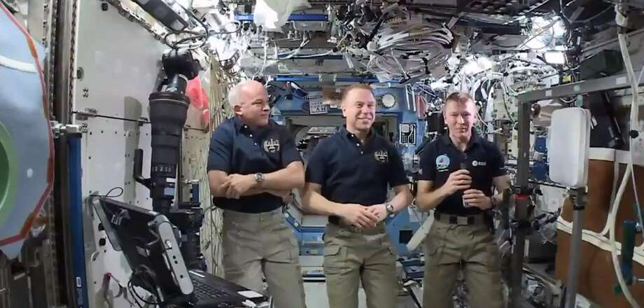 In this image made from video provided by NASA, from left, NASA astronauts Jeffrey Williams and Timothy Kopra, and British astronaut Timothy Peake participate in an interview from the International Space Station on Thursday, April 14, 2016. Peake, Britain's first official spaceman, says he's ready to run the London Marathon in 1 1/2 weeks - from 250 miles up. (NASA via AP) Photo: AP